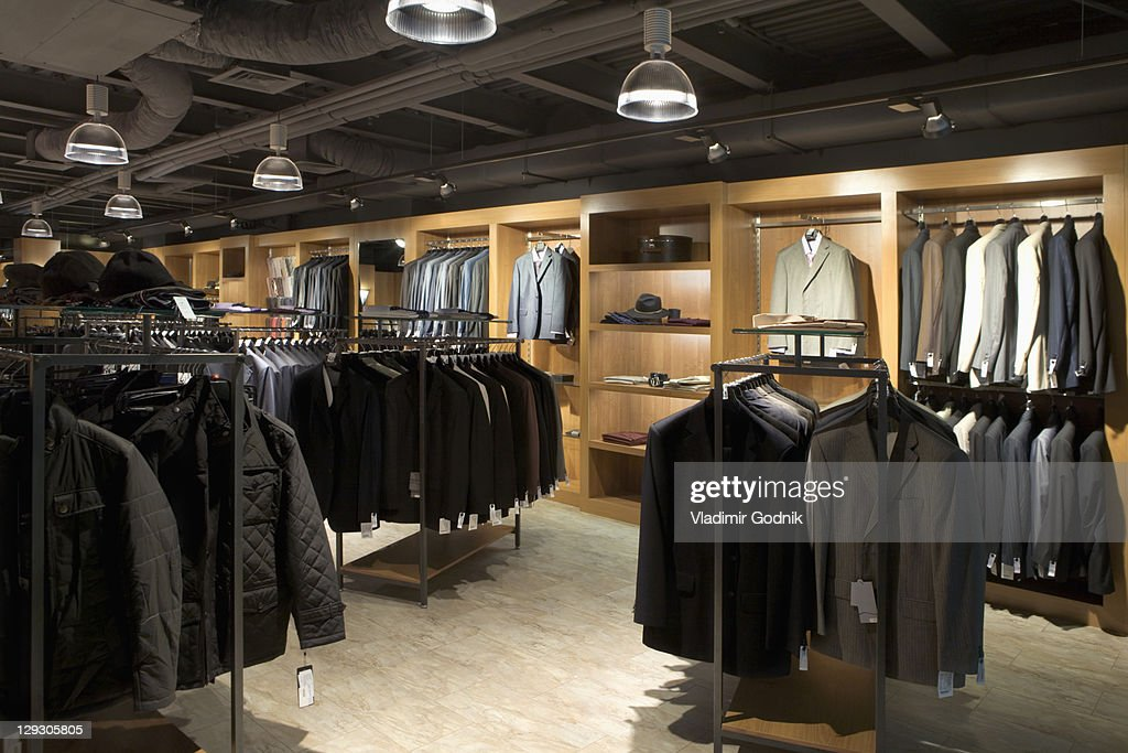 Racks of clothes in a menswear store : Foto stock