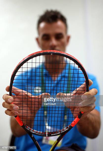 A racquet stringer checks a racquet is properly repaired on day 8 of the Wimbledon Lawn Tennis Championships at the All England Lawn Tennis and...