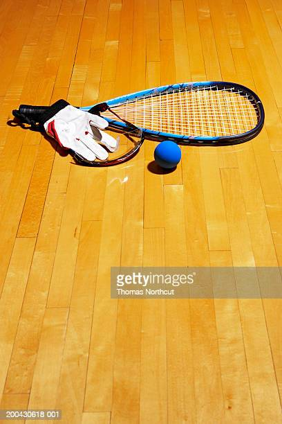 Racquetball racket, ball, glove and protective eyewear on sports court