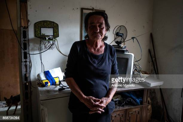 Rada from Serbia poses for a photograph in his room in an occupied building on October 4 2017 in Rome Italy For the last 5 years hundreds of people...