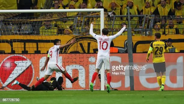 Radamel Falcao and Bernardo Silva of AS Monaco celebrate the own goal scored by Sven Bender of Borussia Dortmund during the UEFA Champions League...