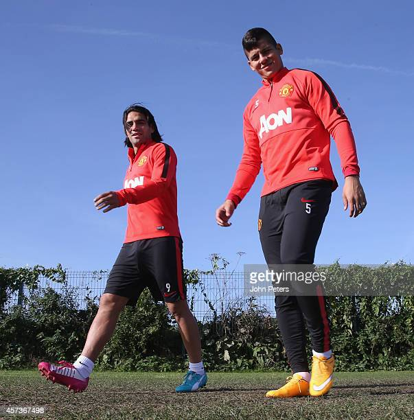 Radamel Falcao and Marcos Rojo of Manchester United in action during a first team training session at Aon Training Complex on October 17 2014 in...