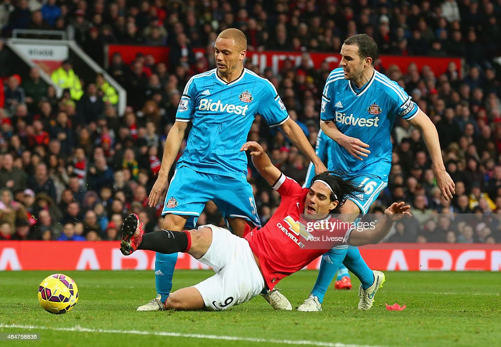 <a gi-track='captionPersonalityLinkClicked' href=/galleries/search?phrase=Radamel+Falcao&family=editorial&specificpeople=3022104 ng-click='$event.stopPropagation()'>Radamel Falcao</a> García of Manchester United is brought down in the area by <a gi-track='captionPersonalityLinkClicked' href=/galleries/search?phrase=Wes+Brown+-+Voetballer&family=editorial&specificpeople=201876 ng-click='$event.stopPropagation()'>Wes Brown</a> and <a gi-track='captionPersonalityLinkClicked' href=/galleries/search?phrase=John+O%27Shea+-+Voetballer&family=editorial&specificpeople=202487 ng-click='$event.stopPropagation()'>John O'Shea</a> of Sunderland to win a penalty during the Barclays Premier League match between Manchester United and Sunderland at Old Trafford on February 28, 2015 in Manchester, England.