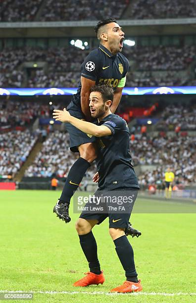 Radamel Falcao Garcia celebrates with Bernardo Silva of AS Monaco after he scored the opener during the UEFA Champions League match between Tottenham...