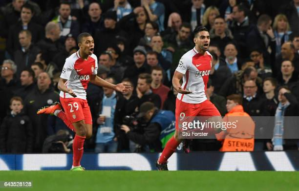 Radamel Falcao Garcia of AS Monaco celebrates with Kylian Mbappe as he scores their third goal during the UEFA Champions League Round of 16 first leg...