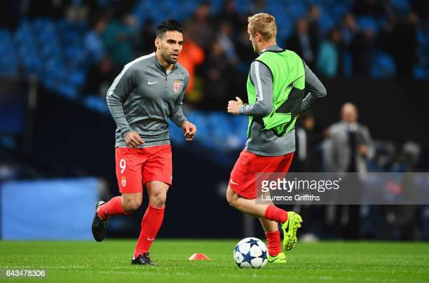 Radamel Falcao Garcia of AS Monaco warms up with team mate Kamil Glik prior to the UEFA Champions League Round of 16 first leg match between...