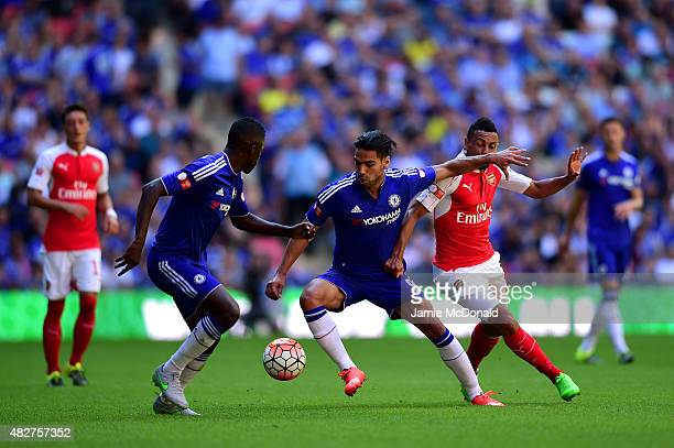Radamel Falcao Garcia of Chelsea and Francis Coquelin of Arsenal compete for the ball during the FA Community Shield match between Chelsea and...