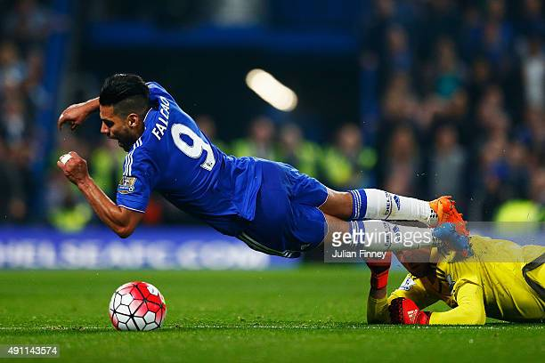 Radamel Falcao Garcia of Chelsea falls resulting in a yellow card for simulation during the Barclays Premier League match between Chelsea and...