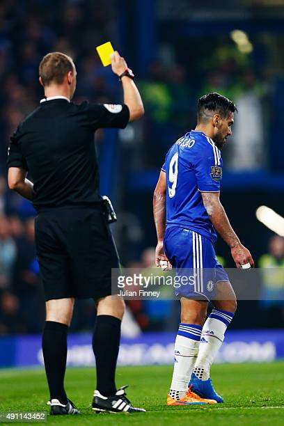Radamel Falcao Garcia of Chelsea is shown a yellow card referee Robert Madley during the Barclays Premier League match between Chelsea and...