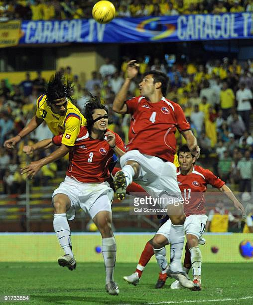 Radamel Falcao Garcia of Colombia vies for the ball with players of Chile during their FIFA World Cup South Africa2010 South American qualifier...