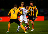 Radamel Falcao Garcia of Manchester United battles for the ball with Greg Taylor and Liam Hughes of Cambridge United during the FA Cup Fourth Round...