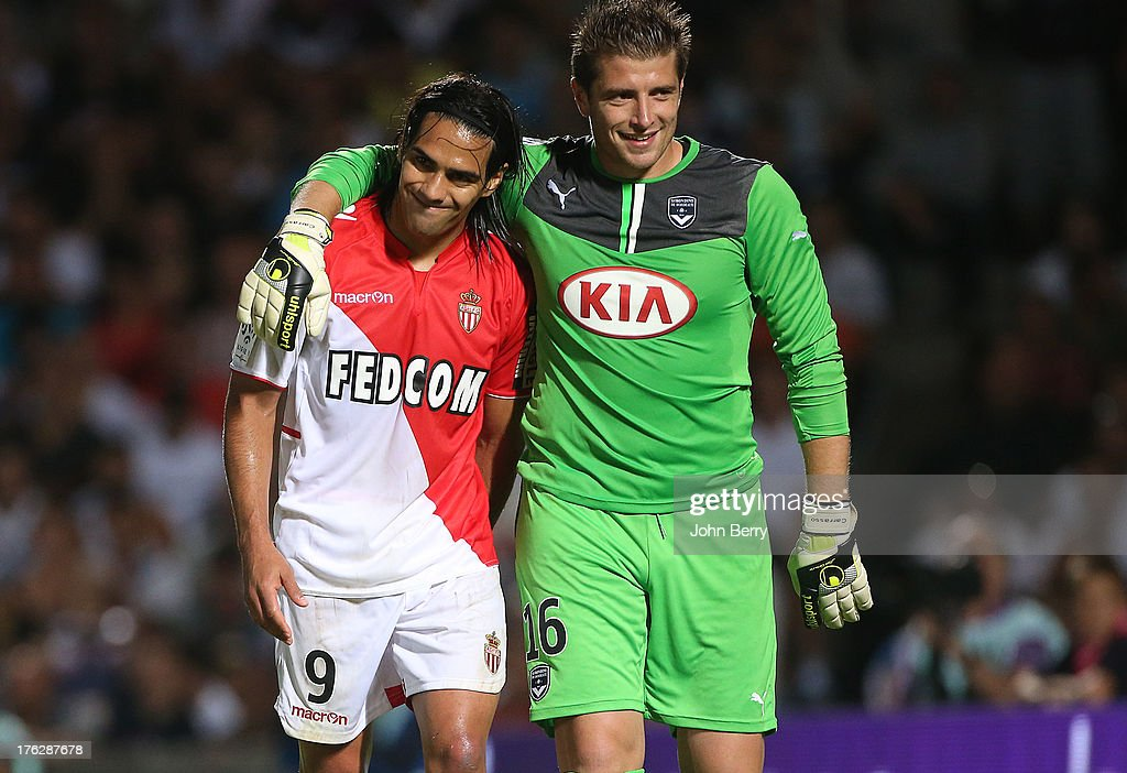 Radamel Falcao of AS Monaco and Cedric Carrasso, goalkeeper of Bordeaux in action during the french Ligue 1 match between FC Girondins de Bordeaux and AS Monaco FC at the Stade Chaban-Delmas stadium on August 10, 2013 in Bordeaux, France.