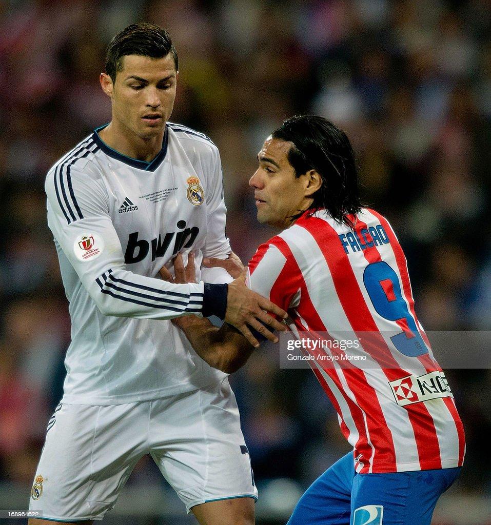 Radamel Falcao of Atletico de Madrid pushes Cristiano Ronaldo of Real Madrid CF during the Copa del Rey Final match between Real Madrid CF and Club Atletico de Madrid at Estadio Santiago Bernabeu on May 17, 2013 in Madrid, Spain.