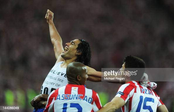 Radamel Falcao of Atletico Madrid celebrates victory with team mates Paulo Assuncao and Pizzi during the UEFA Europa League Final between Atletico...