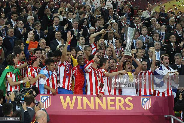Radamel Falcao of Atletico Madrid holds the trophy aloft with his team mates at the end of the UEFA Europa League Final between Atletico Madrid and...