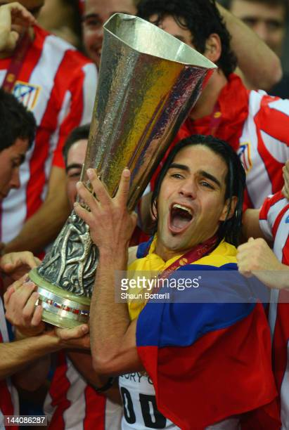 Radamel Falcao of Atletico Madrid holds the trophy with his team mates at the end of the UEFA Europa League Final between Atletico Madrid and...