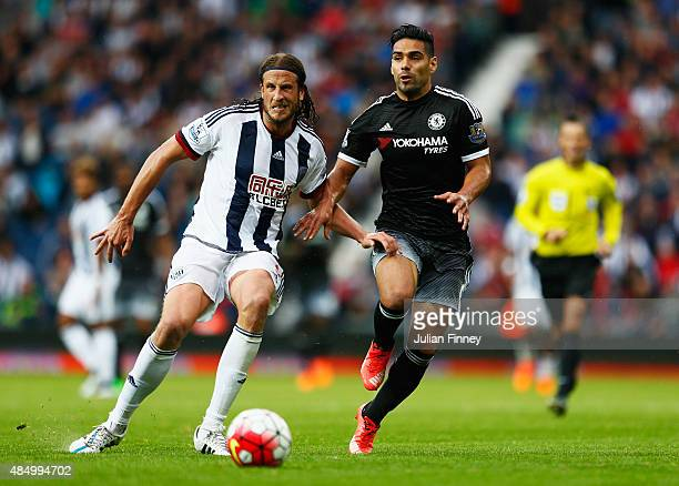 Radamel Falcao of Chelsea challenges for the ball with Jonas Olsson of West Bromwich Albion during the Barclays Premier League match between West...