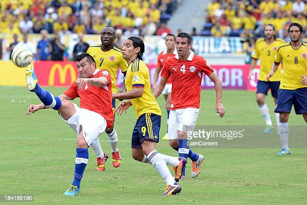 Radamel Falcao of Colombia and Carlos Carmona of Chile fight for the ball during a match between Colombia and Chile as part of the 17th round of the...