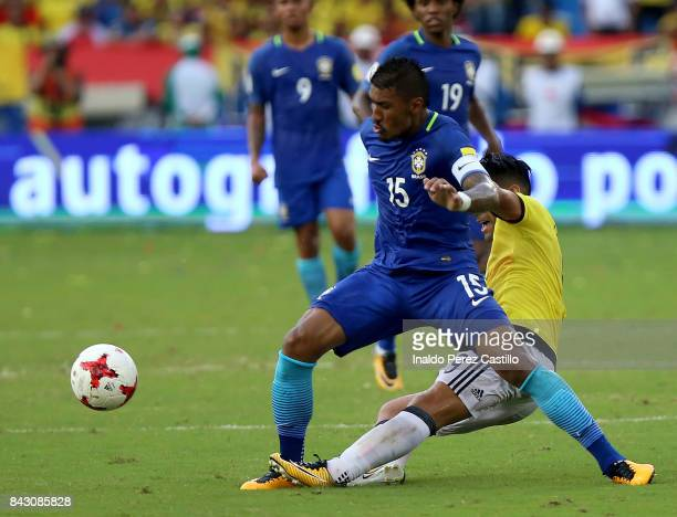 Radamel Falcao of Colombia and Paulinho of Brazil compete for the ball during a match between Colombia and Brazil as part of FIFA 2018 World Cup...