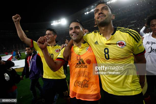 Radamel Falcao of Colombia celebrates with teammates Abel Aguilar and James Rodriguez the qualifying to the World Cup Russia 2018 after the match...