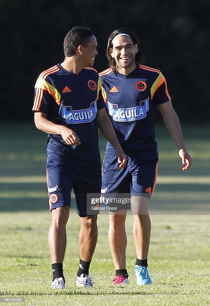 Radamel Falcao of Colombia (R) smiles during a Colombia National Team training session at Sofitel Cardales on May 28, 2014 in Buenos Aires, Argentina.