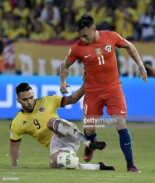 Radamel Falcao of Colombia struggles for the ball with Eduardo Vargas of Chile during a match between Colombia and Chile as part of FIFA 2018 World...