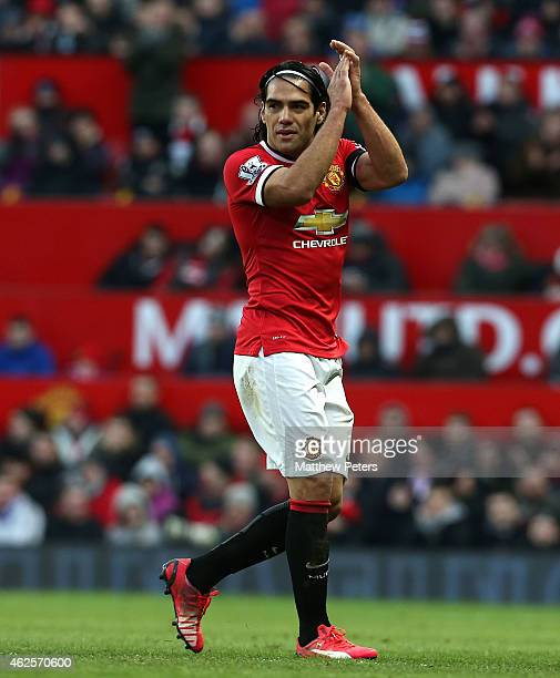 Radamel Falcao of Manchester United applauds the fans after being substituted during the Barclays Premier League match between Manchester United and...