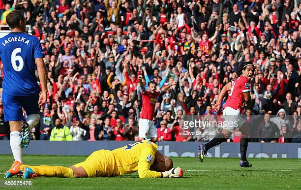 Radamel Falcao of Manchester United celebrates scoring his team's second goal during the Barclays Premier League match between Manchester United and...