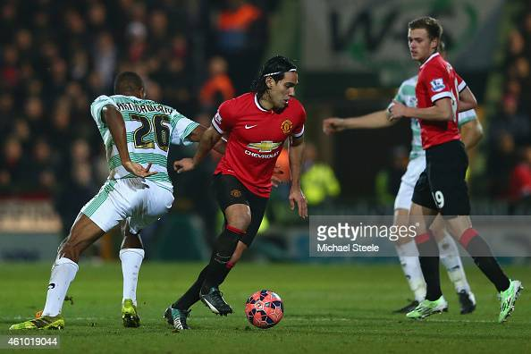 Radamel Falcao of Manchester United is tracked by Stephen Arthurworrey of Yeovil Town during the FA Cup Third Round match between Yeovil Town and...
