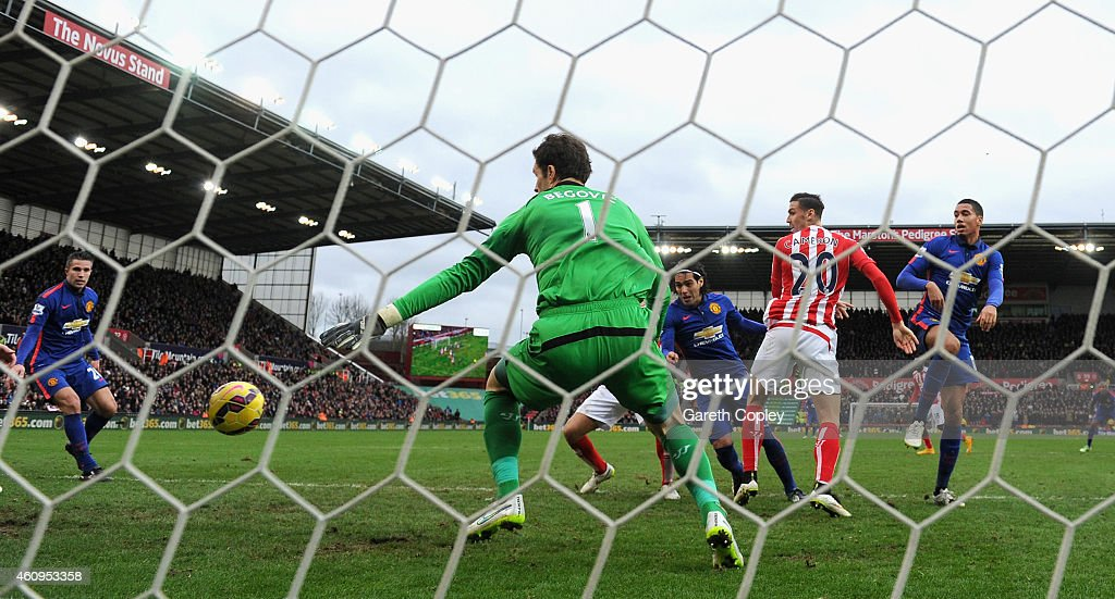 Radamel Falcao of Manchester United scores his team's first goal during the Barclays Premier League match between Stoke City and Manchester United at Britannia Stadium on January 1, 2015 in Stoke on Trent, England.