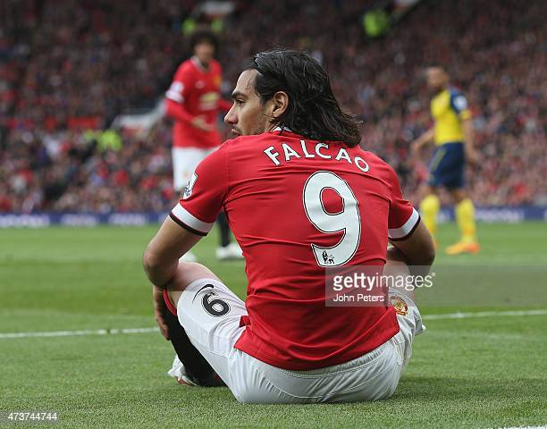 Radamel Falcao of Manchester United sits on the pitch during the Barclays Premier League match between Manchester United and Arsenal at Old Trafford...