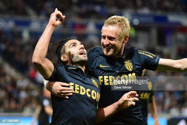 Radamel Falcao of Monaco is congratulated by Kamil Glik of Monaco after putting his side 10 ahead during the Ligue 1 match between Olympique Lyonnais...
