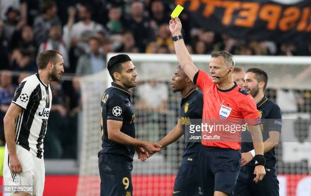 Radamel Falcao of Monaco receives a yellow card from referee Bjorn Kuipers of Netherlands during the UEFA Champions League semi final second leg...