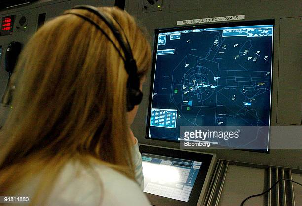 A radar controller monitors air traffic in the radar room of the Irish Aviation Authority's new Air Traffic Control Centre at Dublin Airport Ireland...
