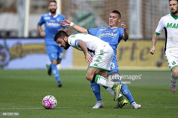Rade Krunic of Empoli FC battles for the ball with Francesco Magnanelli of US Sassuolo Calcio during the Serie A match between Empoli FC and US...