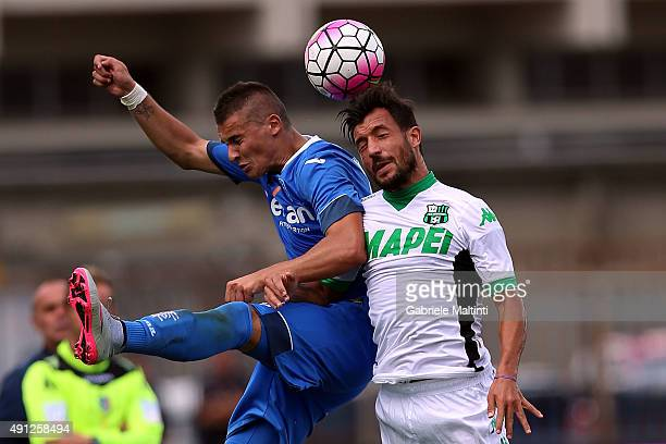 Rade Krunic of Empoli FC battles for the ball with Karim Laribi of US Sassuolo Calcio during the Serie A match between Empoli FC and US Sassuolo...