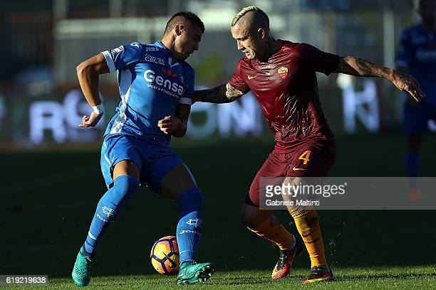 Rade Krunic of Empoli Fc for the ball with Radja Naiggloan of AS Roma during the Serie A match between Empoli FC and AS Roma at Stadio Carlo...