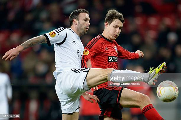 Rade Prica of Rosenborg Trondheim and Philipp Wollscheid of Leverkusen battle for the ball during the UEFA Europa League Group K match between Bayer...