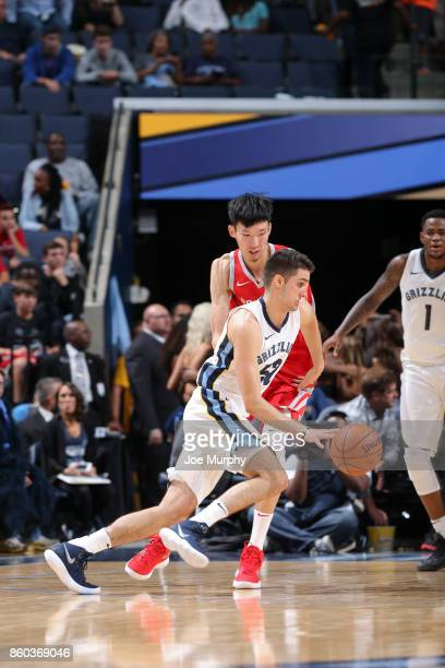 Rade Zagorac of the Memphis Grizzlies handles the ball against Zhou Qi of the Houston Rockets during a preseason game on October 11 2017 at...