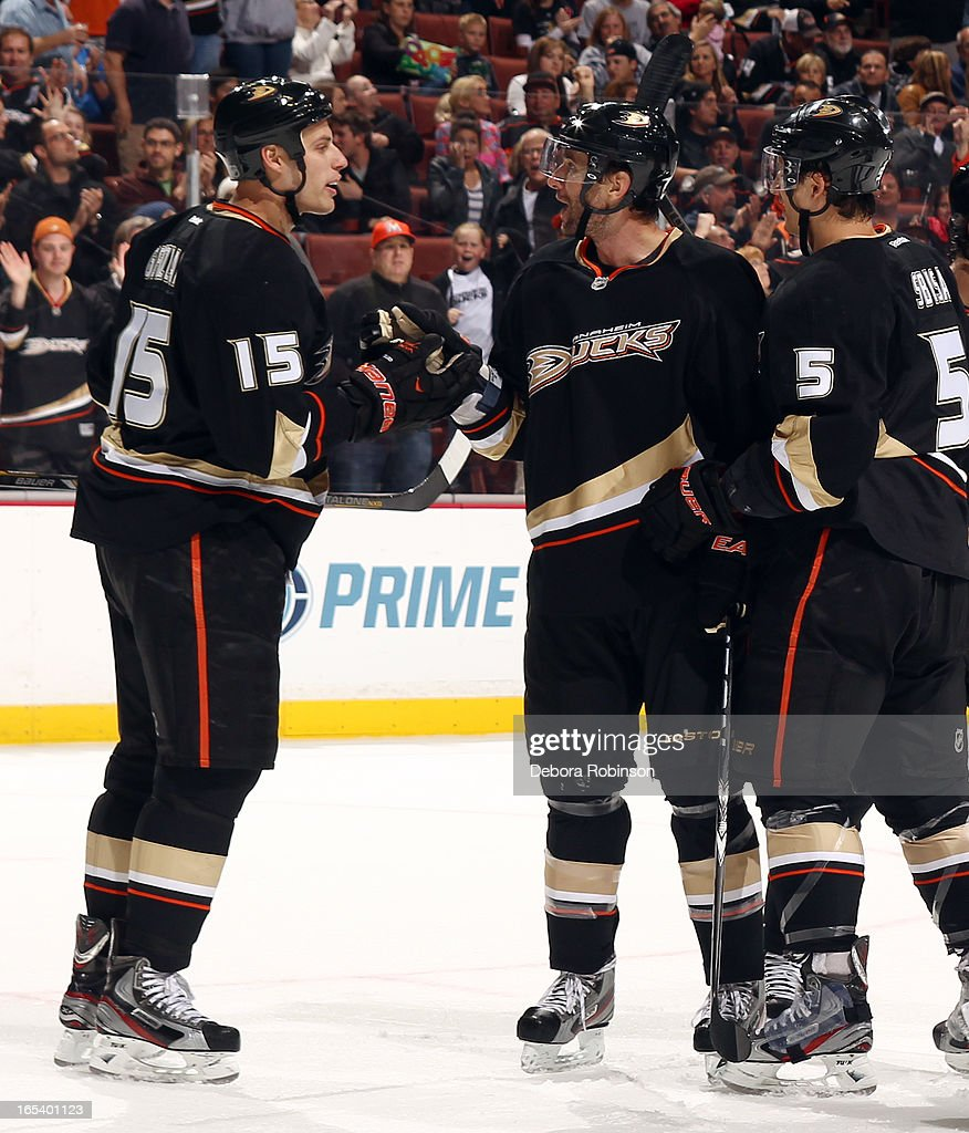 Radek Dvorak #18 of the Anaheim Ducks is congratulated by teammates Ryan Getzlaf #15 and Luca Sbisa #5 after scoring a goal during the game against the Dallas Stars on April 3, 2013 at Honda Center in Anaheim, California.