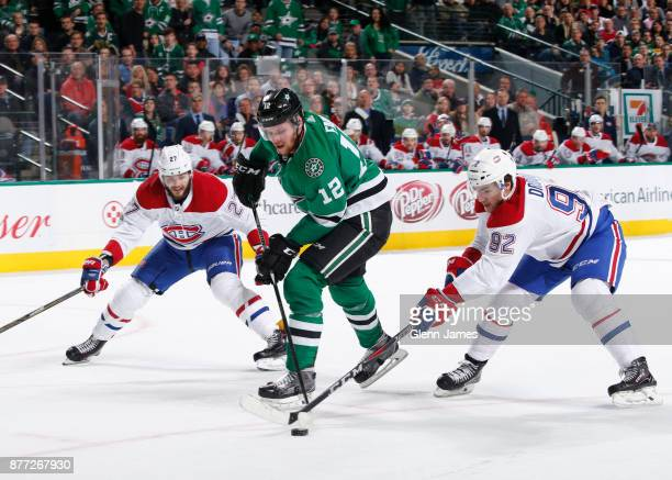 Radek Faksa of the Dallas Stars handles the puck against Jonathan Drouin of the Montreal Canadiens at the American Airlines Center on November 21...