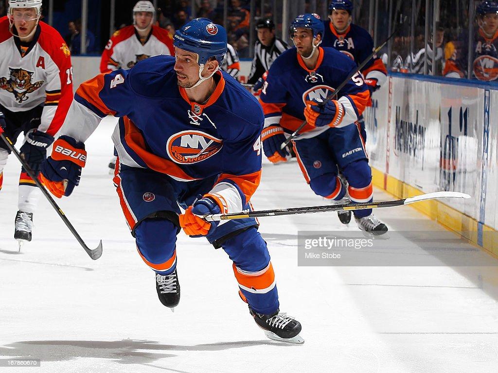Radek Martinek #4 of the New York Islanders skates against the Florida Panthers at Nassau Veterans Memorial Coliseum on April 16, 2013 in Uniondale, New York. The New York Islanders defeated the Florida Panthers 5-2.