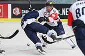 Radek Philipp of HC Kosice and Keith Aucoin of EHC Red Bull Muenchen during the Champions Hockey League group stage game between Red Bull Munich and...