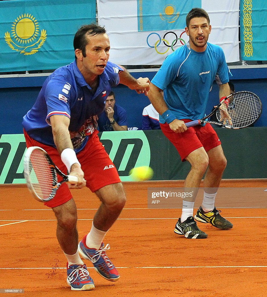 Radek Stepanek (L) and Jan Hajek (R) of the Czech Republic return a service to Evgeny Korolev and Yuriy Schukin of Kazakhstan during their Davis Cup quarter-final doubles match in the Kazakh capital Astana, on April 6, 2013.