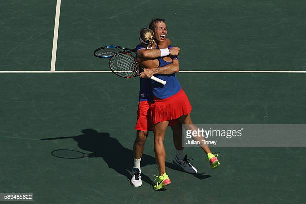 Radek Stepanek and Lucie Hradecka of the Czech Republic celebrate victory in the mixed doubles bronze medal match against Rohan Bopanna and Sania...