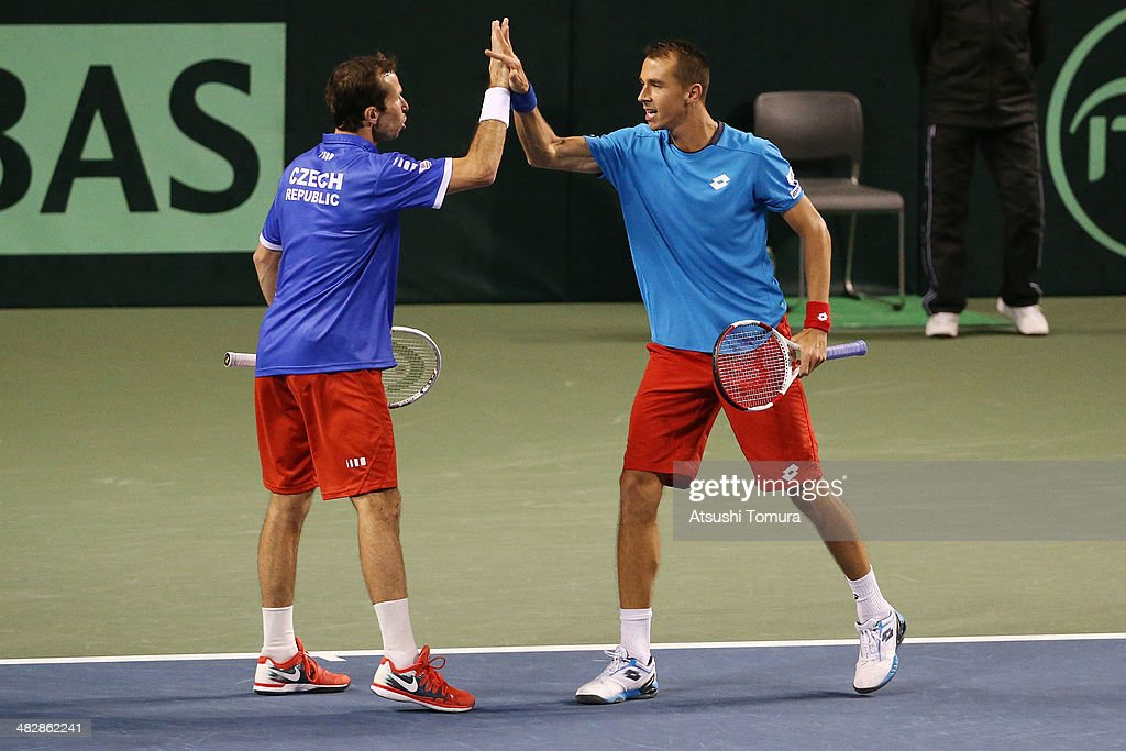 <a gi-track='captionPersonalityLinkClicked' href=/galleries/search?phrase=Radek+Stepanek&family=editorial&specificpeople=193842 ng-click='$event.stopPropagation()'>Radek Stepanek</a> and <a gi-track='captionPersonalityLinkClicked' href=/galleries/search?phrase=Lukas+Rosol&family=editorial&specificpeople=4100845 ng-click='$event.stopPropagation()'>Lukas Rosol</a> of the Czech Republic react during their doubles match against Yasutaka Uchiyama and Tatsuma Ito of Japan during day two of the Davis Cup World Group Quarter Final match between Japan and the Czech Republic at Ariake Coliseum on April 5, 2014 in Tokyo, Japan.