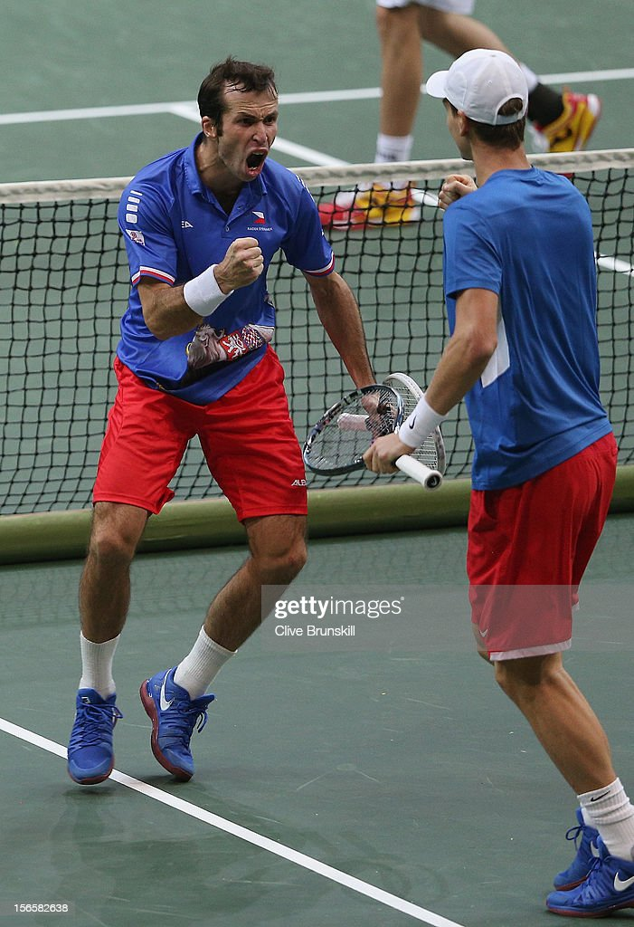 Radek Stepanek and Tomas Berdych of Czech Republic celebrate winning the second set during their doubles match against Marc Lopez and Marcel Granollers of Spain during day two of the final Davis Cup match between Czech Republic and Spain at the 02 Arena on November 17, 2012 in Prague, Czech Republic.