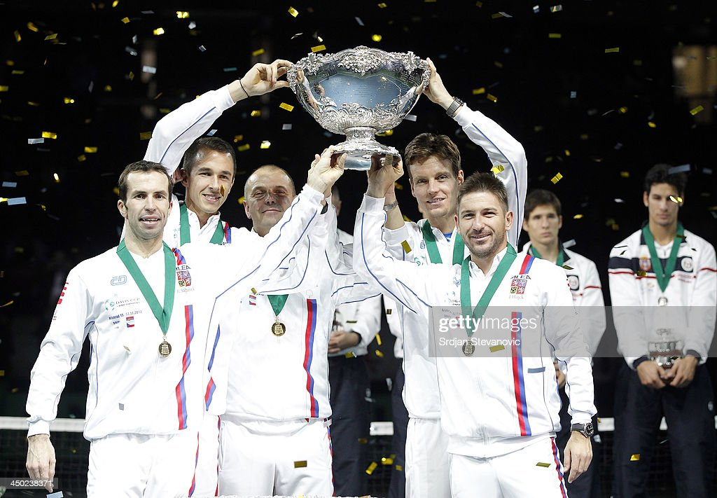 L-R Radek Stepanek Lukas Rosol team captain Vladimir Safarik Tomas Berdych and Jan Hayek of Czech Republic hold the winners trophy aloft after a 3-2 victory against Serbia during the award ceremony of the Davis Cup World Group Final between Serbia and Czech Republic at Kombank Arena on November 17, 2013 in Belgrade, Serbia.