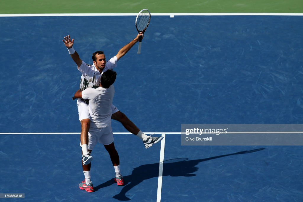 <a gi-track='captionPersonalityLinkClicked' href=/galleries/search?phrase=Radek+Stepanek&family=editorial&specificpeople=193842 ng-click='$event.stopPropagation()'>Radek Stepanek</a> of Czech Republic and <a gi-track='captionPersonalityLinkClicked' href=/galleries/search?phrase=Leander+Paes&family=editorial&specificpeople=215327 ng-click='$event.stopPropagation()'>Leander Paes</a> of India celebrate match point during their men's doubles semi-final match against Bob Bryan and Mike Bryan of the United States of America on Day Eleven of the 2013 US Open at USTA Billie Jean King National Tennis Center on September 5, 2013 in the Flushing neighborhood of the Queens borough of New York City.