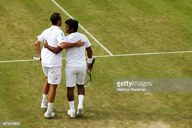 Radek Stepanek of Czech Republic and Leander Paes of India celebrate during their Gentlemen's Doubles third round match against JeanJulien Rojer of...